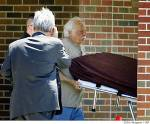 The body of Dr. George Tiller is carried out of his church