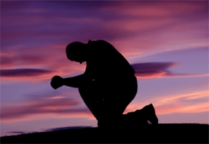 praying on knees