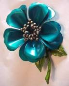 teal enamel flower