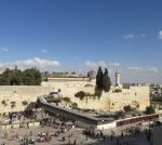 Western Wall, where Jews go to pray, with the dome of Al-Aqsa Mosque, where Muslims pray (part of the third holiest site for Muslims in the world), in the background. Not visible, to the left, is the Dome of the Rock.