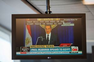 Egyptian President Mubarak's speach broadcast live on a television set to CNN at Kennedy Airport where terror alerts are back on there highest level. While thousands celebrated in Thalir Square anticipating his speach where rumor had it he was stepping down, the crowd grew angry when he didn't resign. The protests in Cairo fueled by the protests in Tunisia were fuled by social media.