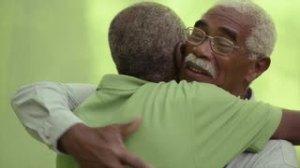 black men older hugging