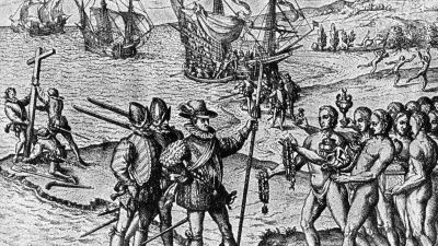 1492, Christopher Columbus (1446 - 1506) lands on Watling Island and meets the natives, while three of his shipmates erect a cross. (Photo by Hulton Archive/Getty Images)
