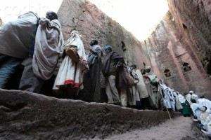 07 Jan 2012, Lalibela, Ethiopia --- Pilgrims making a queue at the corridor into a cave church at Christmas. Simple farmers, many of them have camped around the churches for as long as a week. --- Image by © Kazuyoshi Nomachi/Corbis