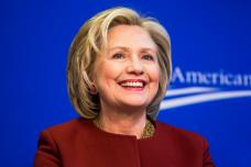 "Former U.S. Secretary of State Hillary Clinton takes part in a Center for American Progress roundtable discussion on ""Expanding Opportunities in America's Urban Areas"" in Washington."